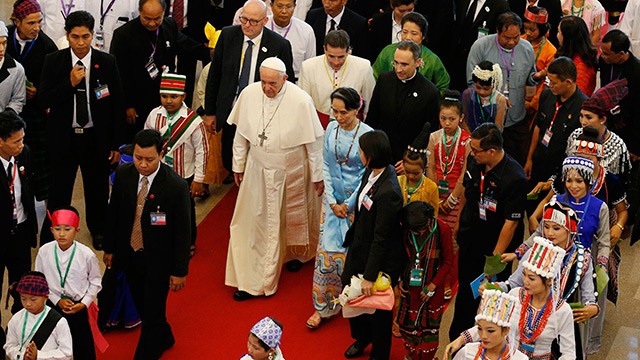 Pope Francis greets children as he arrives at Yangon International Airport in Yangon, Myanmar, Nov. 27. The pope is making a six-day visit to Myanmar and Bangladesh
