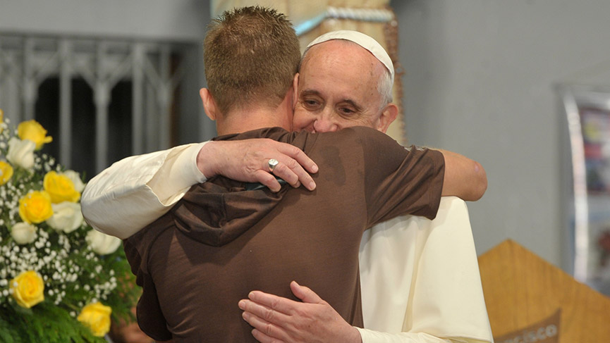 Pope Francis welcome a young person