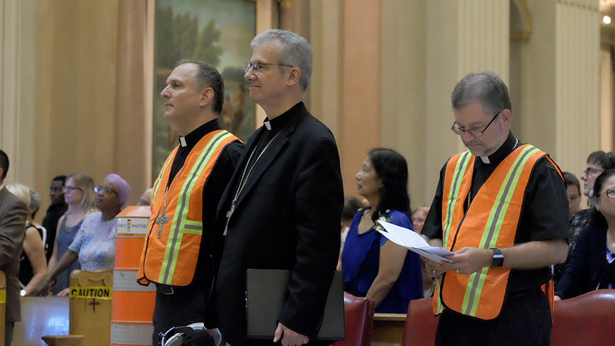 Archbishop Christian Lépine accompanied by his two auxiliary bishops, Alain Faubert and Thomas Dowd, at the 2019 pastoral year launch.