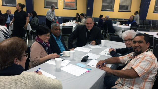 Bishop Alain Faubert with different members of cultural communities in Montreal.
