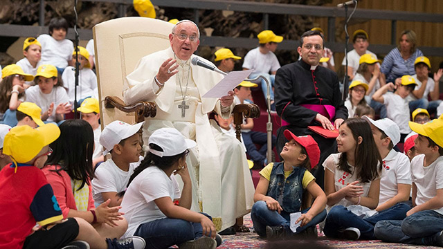 Pope Francis surrounded by kids