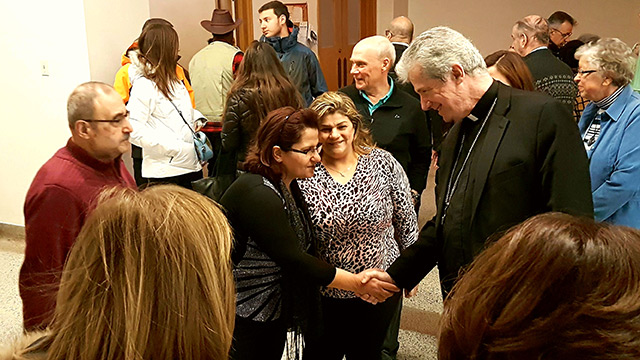 Archbishop Lépine greeting Refugee Families
