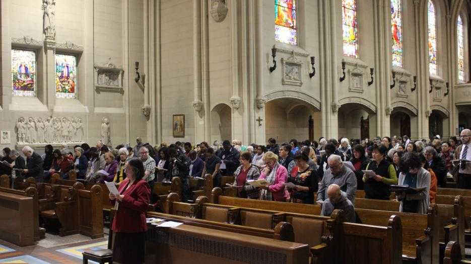The assembly during the Gospel reading.