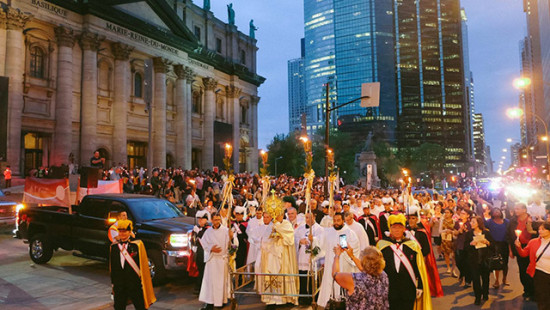 Hundreds of people in procession for Corpus Christi