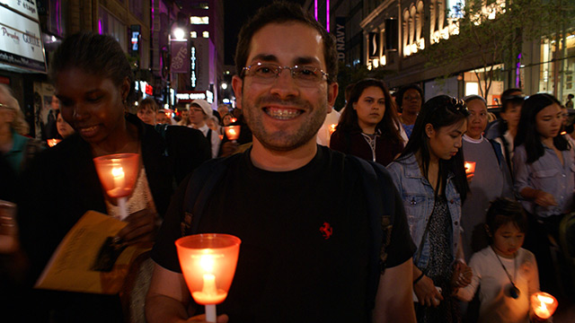 José, arrived from Colombia 2 months ago and participating in the procession with joy! (Photo: Brigitte Bédard)